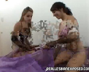 Horny Lesbians having fun with a dildo