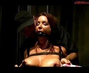 Busty girl with mouthgag bondaged getting her tits rubbed ni