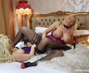 Blonde with big tits has lesbian babe on her bed for pussy and ass licking